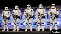 FILE - Redesigned stormtroopers appear onstage at the kick-off event of the Star Wars Celebration convention in Anaheim, California, April 16, 2015.