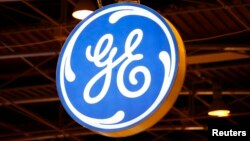 FILE - The logo of General Electric is pictured at the 26th World Gas Conference in Paris, France, June 2, 2015.