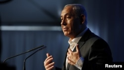 Israel's Prime Minister Benjamin Netanyahu delivers a speech during a cornerstone laying ceremony for a new hospital in the port city of Ashdod, November 8, 2012.