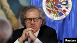 FILE - OAS Secretary General Luis Almagro attends a news conference inside the presidential house in Tegucigalpa, Honduras, Aug. 8, 2015.