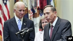 Director of the CIA, David Petraeus (R), speaks following his swearing-in ceremony with his wife Holly Knowlton Petraeus (C), and Vice President Joe Biden (L), in the Roosevelt Room of the White House in Washington, DC, September 6, 2011.