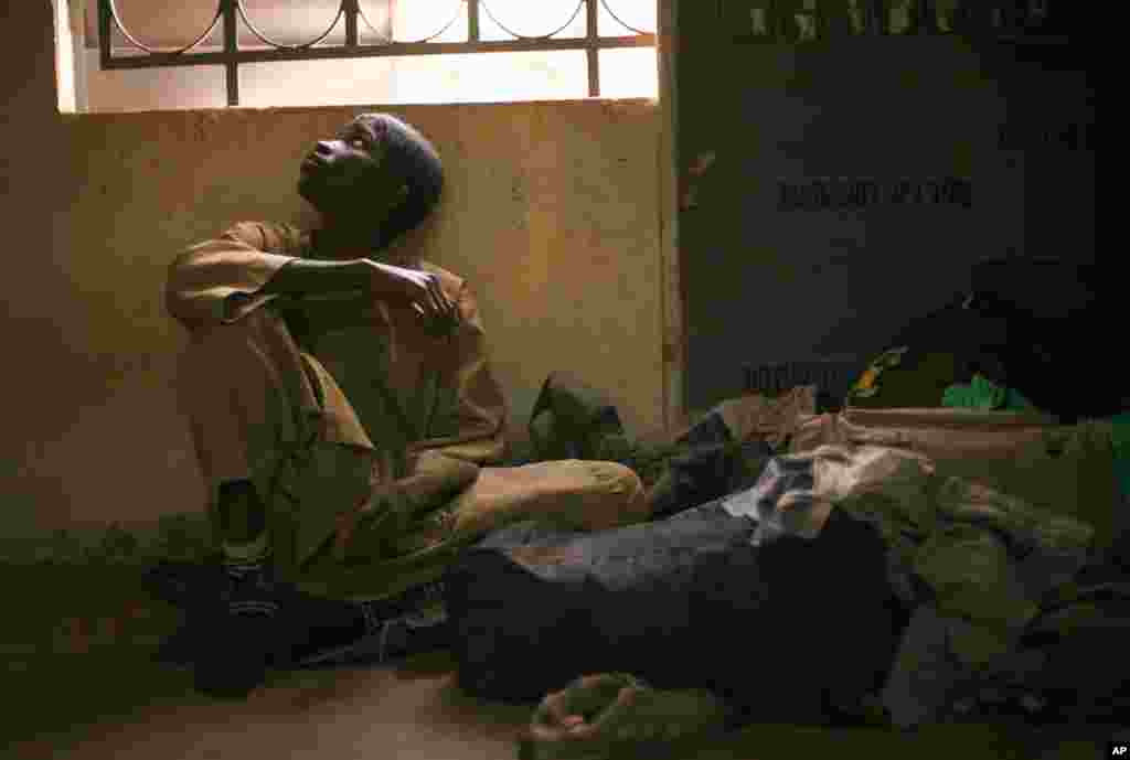 Adama Drabo, 16, sits in the police station in Sevare, Mali, January 25, 2013. He was captured traveling without papers by Malian troops and arrested on suspicion of working for Islamic militant group MUJAO.