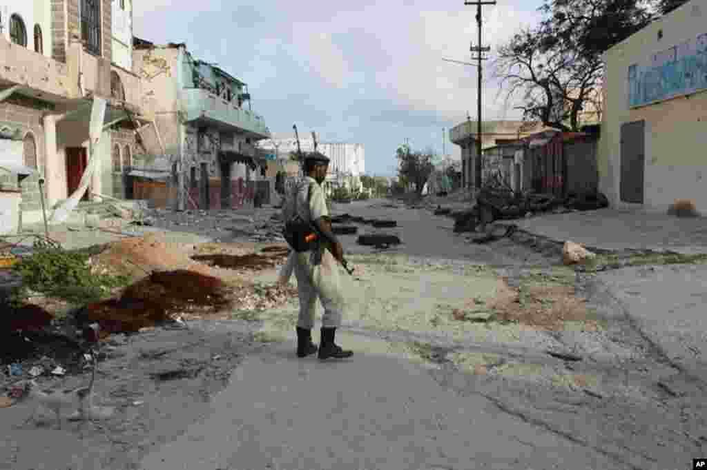 A solitary soldier surveys the damage (VOA - P. Heinlein)