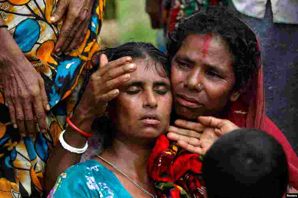 Hindu villagers react as they identify the bodies of their relatives found by government forces, and which authorities suspect were killed by insurgents last month, in a mass grave near Maungdaw in the north of Myanmar's Rakhine state.
