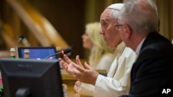 Pope Francis speaks in the Synod Hall at the Vatican during a conference on climate change and human trafficking, July 21, 2015.