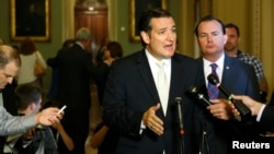 U.S. Senator Ted Cruz (C) and Senator Mike Lee (2nd R) speak to reporters about their opposition after the Senate passed a spending bill to avoid a government shutdown, at the U.S. Capitol, Sept. 27, 2013.