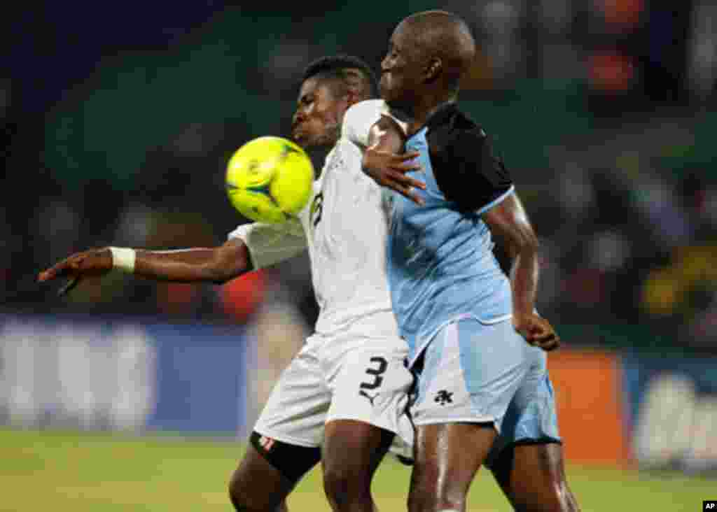 Ghana's Gyan challenges Ananan of Botswana during their African Cup of Nations Group D soccer match in FranceVille Stadium