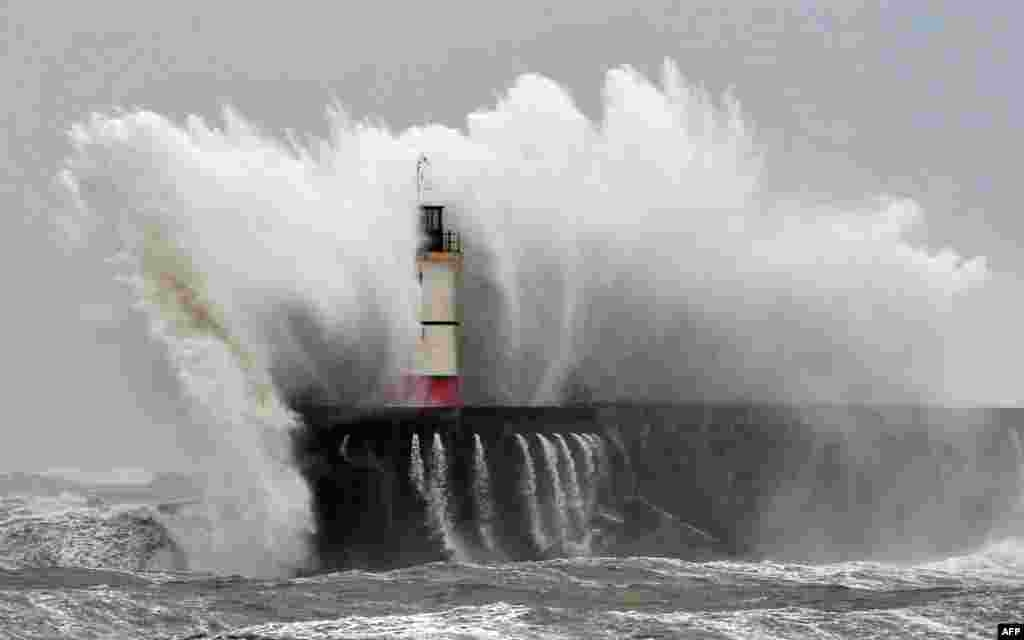 Newhaven Lighthouse is battered by waves during stormy weather on the southern coast of England. More than 8,000 homes were without power in southwest England after fresh storms battered the region, sending huge waves crashing onto the coastline and damaging sea defenses.