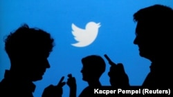 Twitter log owith silhouettes