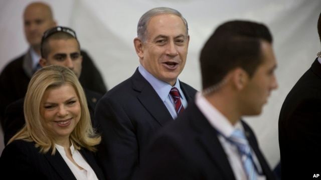 FILE - Israeli Prime Minister Benjamin Netanyahu and his wife Sara are seen arriving for the Likud party primary elections in Jerusalem in a Dec. 31, 2014, photo.