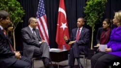 President Barack Obama meets with the Prime Minster Erdogan of Turkey during the Nuclear Security Summit at the Walter E. Washington Convention Center in Washington, D.C., April 13, 2010. (Official White House Photo by Pete Souza)