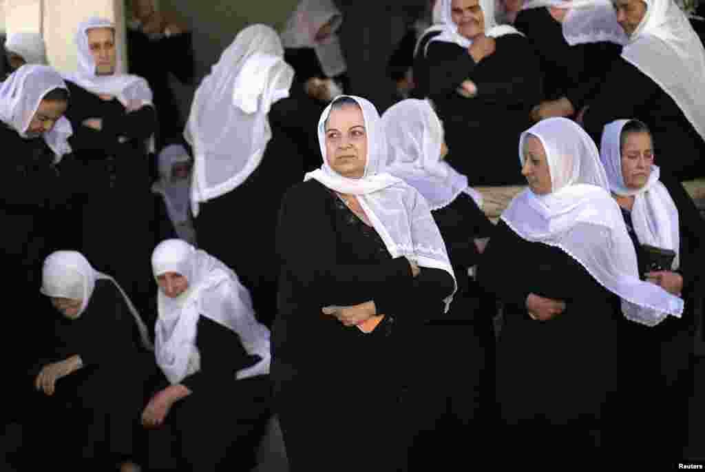 Druze women mourn during the funeral of Israeli border police officer Jedan Assad in the village of Beit Jann in Israel's northern Galilee.
