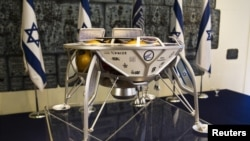 FILE - A model of a SpaceIL spacecraft is displayed in Jerusalem, Oct. 7, 2015. The Israeli team is competing in a race to the moon sponsored by Google.