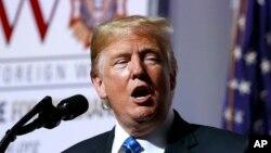 En la foto, el presidente Donald Trump habla durante la Convención Nacional de Veteranos de Guerras Extranjeras de los Estados Unidos, el martes 24 de julio de 2018 en Kansas City, Mo. (AP Photo / Evan Vucci).