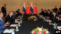 Russia's President Vladimir Putin (2nd L) holds talks with his China's counterpart Xi Jinping in Fortaleza, Brazil, on July 15, 2014.