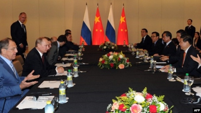 Talks in July between Russia's President Vladimir Putin, second from left, with his Chinese counterpart, Xi Jinping, right, in Fortaleza, Brazil, came as the two countries find an increasing number of areas of policy overlap.