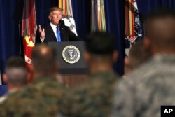 FILE - President Donald Trump speaks at Fort Myer in Arlington Va., Aug. 21, 2017, during an address to the nation about a strategy he believes will best position the U.S. to eventually declare victory in Afghanistan.