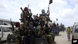 Al-Shabab fighters display weapons as they conduct military exercises in northern Mogadishu, Somalia, (File).