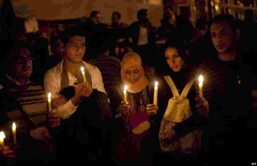 Anti-government protestors hold candles as they take part in a demonstration at Tahrir square in Cairo, Egypt, Wednesday, Feb. 9, 2011. Protesters appear to have settled in for a long standoff, turning Tahrir Square into a makeshift village with tens of t
