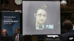 National Security Agency leaker Edward Snowden speaks via video link during the Athens Democracy Forum, organized by the New York Times, at the National Library in Athens on Sept. 16, 2016.