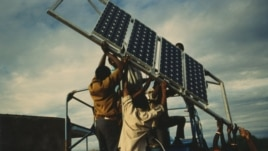 Men offload an array of solar panels for use in Tanzania. The SELF NGO is calling on governments to do more to give 'clean' electricity to Africans.(Courtesy SELF)