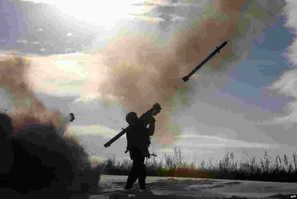 A Ukrainian soldier fires a missile with a man-portable air-defense system during exercices near the city of Shchastya, north of Lugansk.