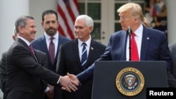 Brian Cornell, the CEO of Target Corporation, shakes hands with U.S. President Donald Trump after the president declared the coronavirus pandemic a national emergency March 13, 2020. (REUTERS/Jonathan Ernst)