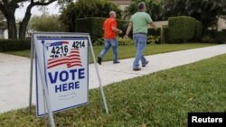 Voters walk to a polling precinct on primary day in Florida for the U.S. presidential election in Boca Raton, Florida, March 15, 2016..