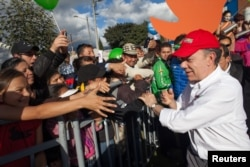 Colombia's President and presidential candidate Juan Manuel Santos greets supporters during the closing campaign rally in Bogota, May 18, 2014.