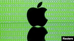 FILE - A 3-D printed Apple logo is seen in front of a displayed cyber code in this illustration taken Feb. 26, 2016.