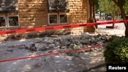 Stonework litters the sidewalk outside an empty jewelry store at the corner of Sixth and Harrison in Pawnee, Oklahoma, after a 5.6 magnitude earthquake struck near the north-central Oklahoma town, Sept. 3, 2016.