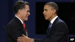 Republican presidential nominee Mitt Romney and President Barack Obama shake hands after the first presidential debate at the University of Denver, in Colorado, Oct. 3, 2012.