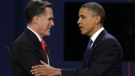 Republican presidential nominee Mitt Romney and President Barack Obama shake hands after the first presidential debate at the University of Denver, in Colorado, Oct. 3, 2012.p