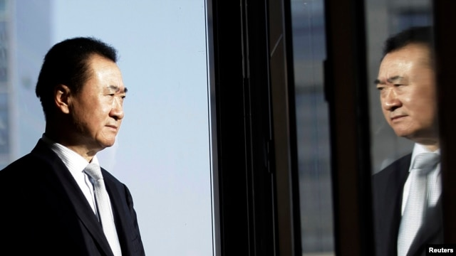 Wang Jianlin, chairman of Dalian Wanda Group and China's richest person, poses for a photo during an interview at his office in Beijing in this December 3, 2012, file photo.