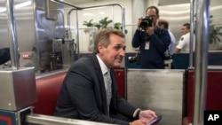 Sen. Jeff Flake, R-Ariz., boards the subway on Capitol Hill in Washington, Thursday, Nov. 30, 2017.