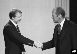 File - President Gerald Ford, right, and Jimmy Carter shake hands before they start their debate.