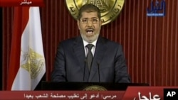 In this image made from video, Egyptian President Mohammed Morsi delivers a televised statement in Cairo, Egypt, Thursday, Dec. 6, 2012.