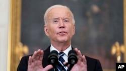 President Joe Biden speaks in the State Dining Room at the White House, Sept. 9, 2021, in Washington.
