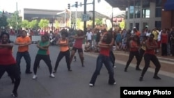 AfroMob performs contemporary African dance for surprised spectators