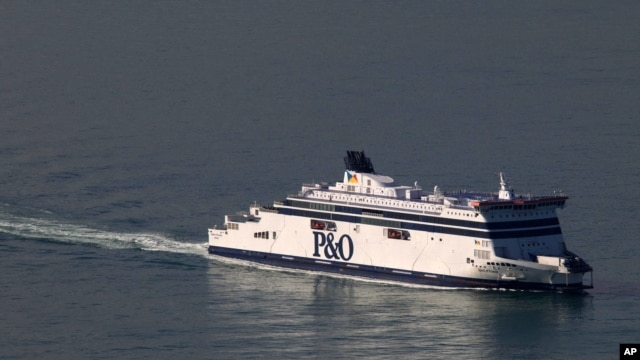 FILE - A P&O cross-channel ferry arrives at Calais harbour, northern France, Sept. 25, 2015.