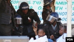 Two journalists who were arrested for covering a public protest freelancer Robert Tapfumaneyi and Newsday's Obey Manati.