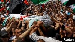 Hàng ngàn người tham dự tang lễ thiếu niên Palestine bị giết chết tại Shuafat, ngày 4/7/2014.