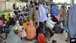 Civilians who fled their homes following an attacked by Islamist militants in Bama, take refuge at a School in Maiduguri, Nigeria, Sept. 3, 2014.