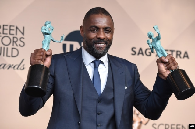 """Idris Elba poses in the press room with the award for outstanding male actor in a supporting role for """"Beasts of No Nation"""" and the award for outstanding male actor in a TV movie or miniseries for """"Luther"""" at the 22nd annual Screen Actors Guild Awards in Los Angeles, Jan. 30, 2016."""