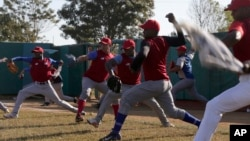 Members of Cuba's national baseball team take part in a training session in San Jose de las Lajas, Mayabeque province, Cuba, March 17, 2016.