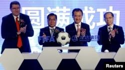 (L-R) FIFA Marketing Director Thierry Weil, FIFA Vice-President David Chung, the chairman of Dalian Wanda Group in China Wang Jianlin and the first vice president of the Football Association of the People's Republic of China Zhang Jian attend an event announcing strategic partnership between Wanda Group and FIFA in Beijing on March 21, 2016