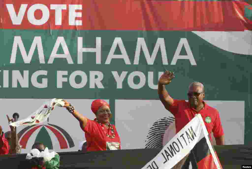 John Dramani Mahama (R), Ghana's interim president and National Democratic Congress (NDC) presidential candidate, waves during his last electoral rally, Accra, Ghana, December 5, 2012.