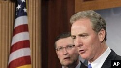 Rep. Chris Van Hollen (r) accompanied by Senate Budget Committee Chairman Sen. Kent Conrad speaks about the Congressional Budget Office's economic outlook during a news conference on Capitol Hill, Jan 26 2011