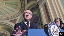 Senate Majority Leader Harry Reid of Nevada speaks to reporters on Capitol Hill in Washington (file photo)
