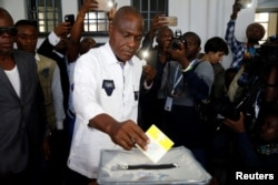 FILE - Martin Fayulu, Congolese joint opposition presidential candidate, casts his vote at a polling station in Kinshasa, Democratic Republic of Congo, Dec. 30, 2018.